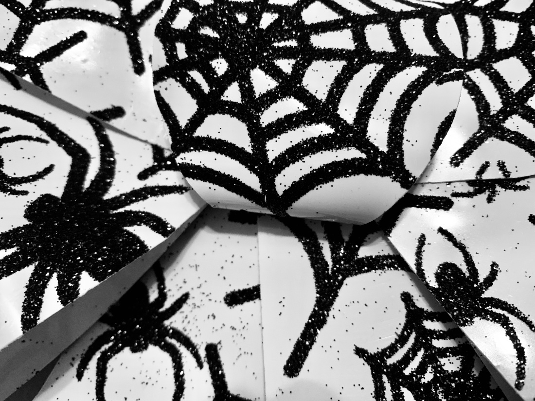 Ribbon with glitter and spiders.