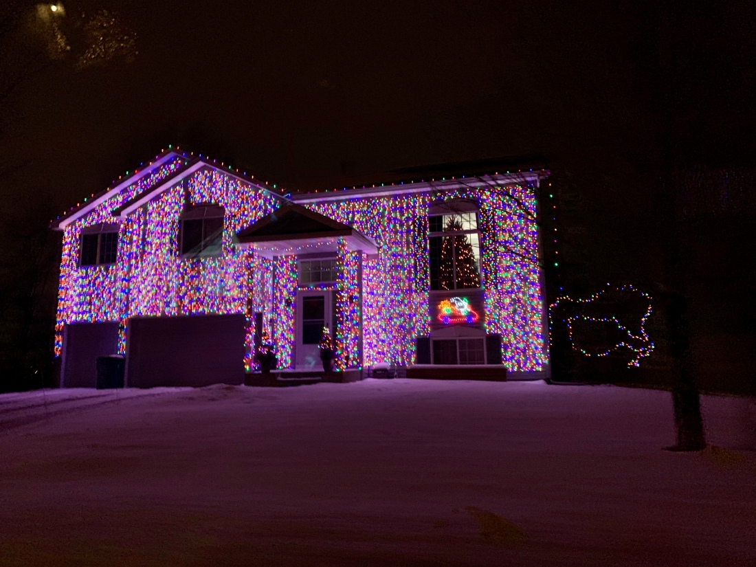 House completely covered in lights.