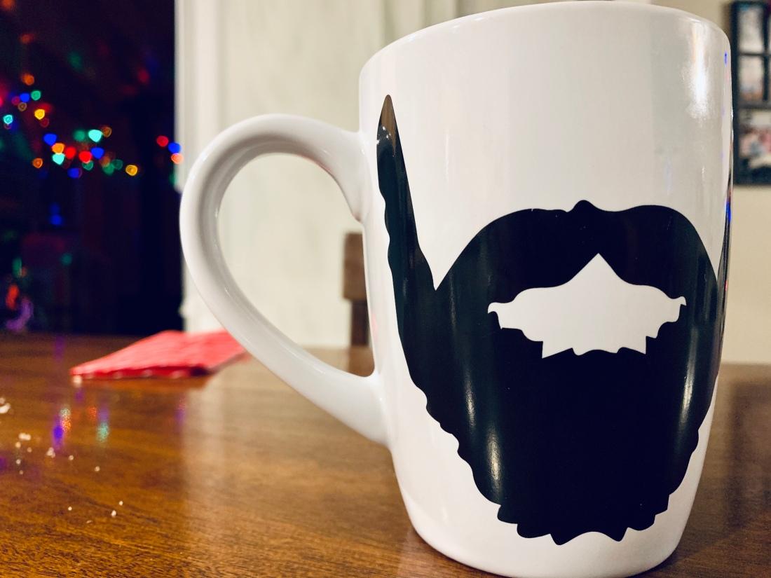 Mug with bears on it sitting on table.